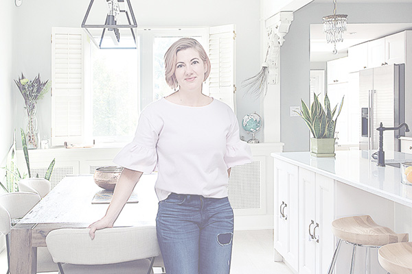 Melissa Peretti Standing in Kitchen